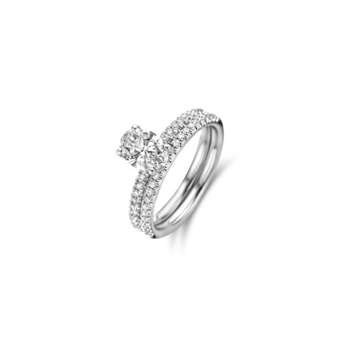 Oval cut solitaire ring with side diamonds and matching wedding ring